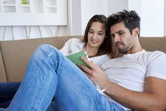 Couple at modern home using tablet computer Royalty Free Stock Photos