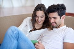 Couple at modern home using tablet computer Stock Photography