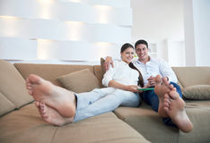 Couple at modern home using tablet computer Royalty Free Stock Photography