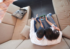 Couple at modern home using tablet computer Stock Image
