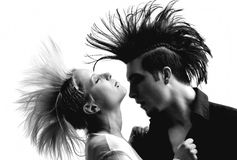 Couple with mohawk. Hugging and kissing couple with crazy hairstyle Stock Image