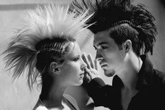 Couple with mohawk 1. Affection couple with crazy hairstyle Stock Images