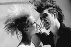 Couple with mohawk 2. Affection couple with crazy hairstyle Royalty Free Stock Photos