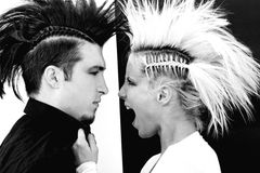 Couple with mohawk 3. Affection couple with crazy hairstyle Royalty Free Stock Photos