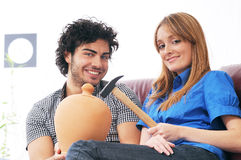Couple and moneybox. Young couple with moneybox and your savings Stock Photo
