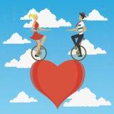 Couple in monocycle Stock Photos