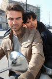Couple on a moped Stock Photography