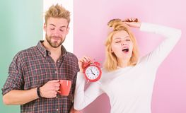 Couple morning awakening alarm clock. Create healthy rest regime to sleep enough. Regret late regime. We should go to. Bed earlier. Woman and men sleepy tousled stock image