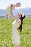 Couple mother and her baby on the camomile meadow Royalty Free Stock Image