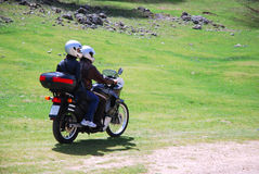 Couple in moto. Young couple in mountain with moto Stock Images