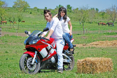 Couple on a motorbike Stock Photography