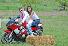 Couple on a motorbike Stock Images