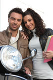 Couple with motorbike Stock Images