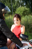 Couple with motorbike Royalty Free Stock Images