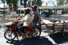 Couple on the motorbike in Cambodia Royalty Free Stock Photography