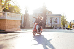 Couple on motorbike in city Stock Image