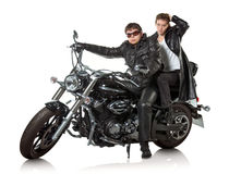 Couple on motorcycle. Couple in a black leather sitting on black custom motorcycle Royalty Free Stock Photos