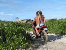 Couple in motorcycle. In dunes Royalty Free Stock Photo