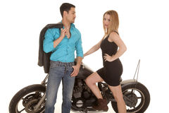 Couple by motorcycle blue shirt dress Royalty Free Stock Photo