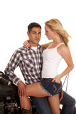 Couple motorcycle hand on leg serious look Royalty Free Stock Images