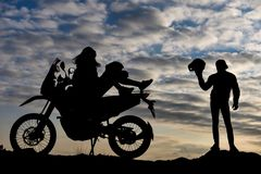 Couple with motorcycle at sunset stock photos