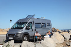 Couple with motorhome royalty free stock photography