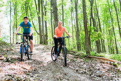 Couple on mountain bike bicycle Stock Photo