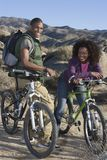 Couple With Mountain Bikes Royalty Free Stock Photo