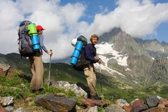 Couple of mountain-climbers Royalty Free Stock Photography