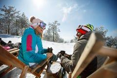 Couple in mountain enjoy in sunbed on ski terrain Stock Image