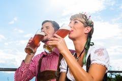 Couple on mountain hut drinking wheat beer Stock Photo