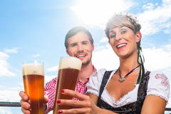 Couple on mountain hut drinking wheat beer Royalty Free Stock Images