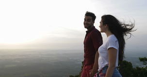 Couple At Mountain Top Holding Hands Talking, Latin Man Showing Woman View Point Finger. Couple At Mountain Top Holding Hands, Latin Man Showing Woman Morning stock video