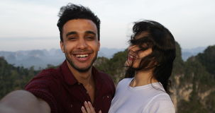 Couple On Mountain Top Taking Selfie Photo, Hispanic Man And Woman Happy Smiling stock video footage