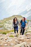 Couple on a mountain trail Stock Photo