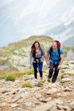 Couple on a mountain trail Stock Photo