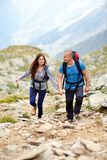 Couple on a mountain trail Stock Images