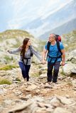 Couple on a mountain trail Royalty Free Stock Images