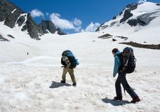 Couple of mountaineer climb to pass Royalty Free Stock Photography