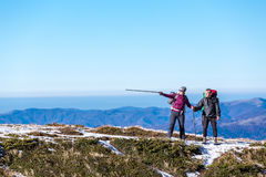 Couple in mountains searching for right way Stock Photography