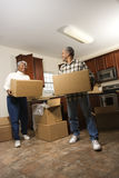 Couple With Moving Boxes Royalty Free Stock Photography