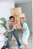 Couple with moving boxes. Portrait of a couple with moving boxes Stock Images