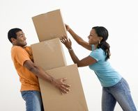 Couple with moving boxes. Royalty Free Stock Images