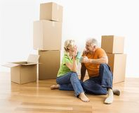 Couple with moving boxes. Stock Images