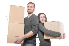 Couple with moving boxes Royalty Free Stock Images