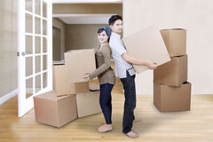 Couple moving boxes in new house Stock Photography