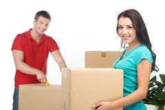 Couple moving boxes and unpacking stuff. Stock Photos