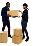 Couple moving empty cartons Stock Photography