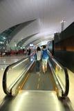 Couple moving at escalator Indore  Dubai international Airport Stock Photography