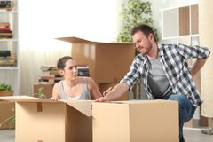 Couple moving home and man having an accident stock images